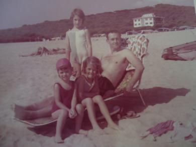 Me with my sisters and dad... very young